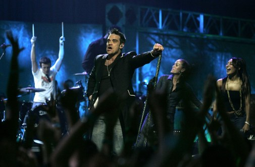 British singer Robbie Williams performs during the 2006 MTV Latin Video Music Awards at the Palacio de los Deportes in Mexico City on Thursday, Oct. 19, 2006. (AP Photo/Guillermo Arias)
